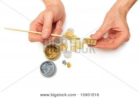 Bullion. Men's Hands, Gold And Silver Coins, Brush, Paint Cans