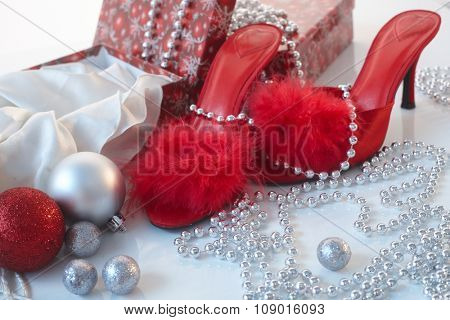 Christmas time in red with high heel slippers and boxes.