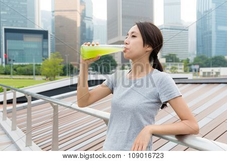 Young Woman drink with vegetable beverage at outdoor