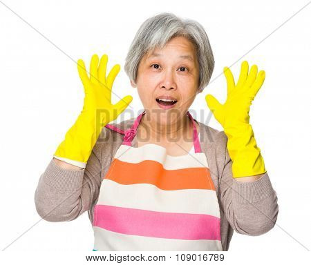 Excited Grandmother holding up hand with plastic gloves