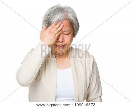 Asian Old woman feeling headache