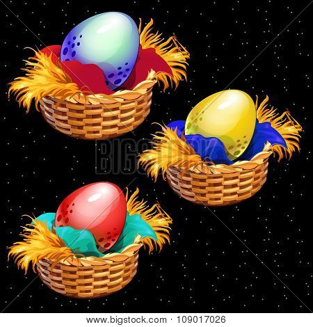 Three colored eggs closeup in straw baskets on a black background