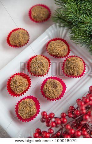 Homemade chocolate truffles on a christmas background