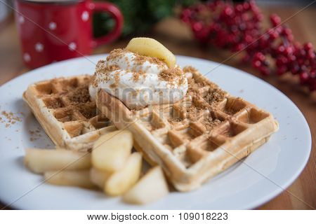 Home made waffles with clotted cream and cinnamon apples