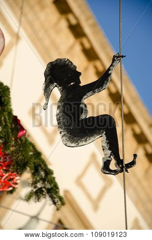 elf swinging on a rope