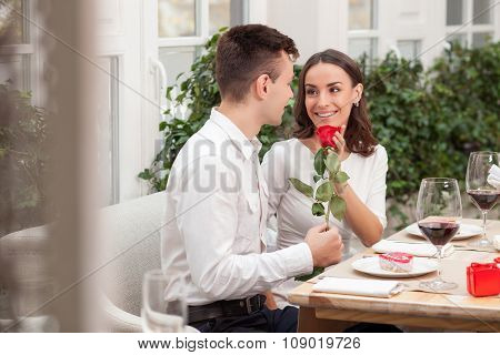 Cheerful loving couple is dating in cafe
