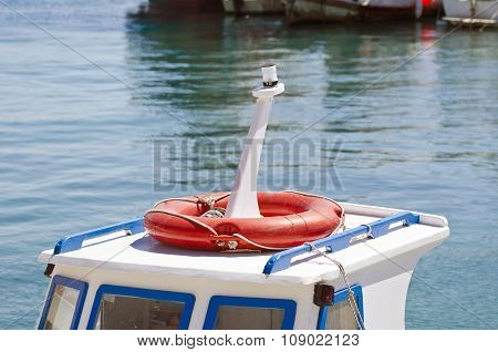 Roof Of A Boat With Orange Lifebuoy In  Harbor
