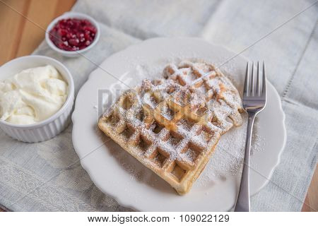Belgian waffles with whipped cream and jam