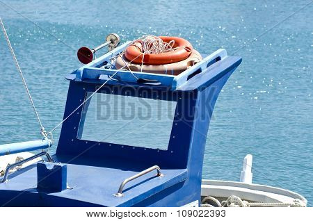 Roof Of Blue Boat With Orange Lifebuoys