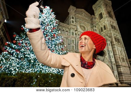 Happy Woman Taking Selfie Near Christmas Tree In Florence, Italy