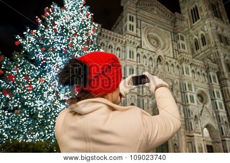 Woman Taking Photos Near Christmas Tree In Florence, Italy