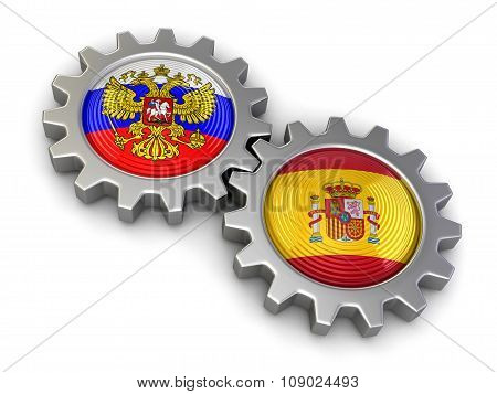 Russian and Spanish flags on a gears (clipping path included)