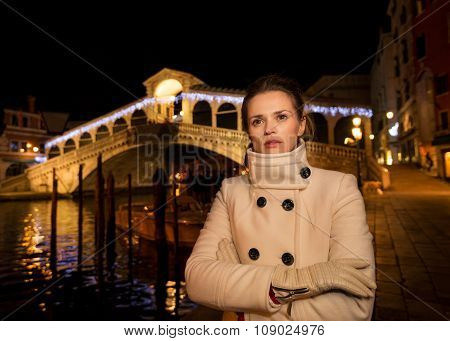 Woman In White Coat. Rialto. Christmas Time In Venice, Italy