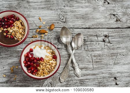 Healthy Breakfast - Yogurt With Homemade Granola And Pomegranate On The Bright  Wooden Board.