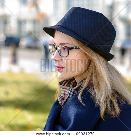 Girl In Hat And Glasses With Golden Hair