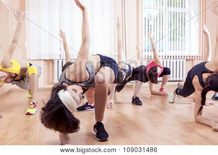 Sport, Training Anf Healthy Lifestyle Concepts. Group Of Caucasian Women Taking Part In Gym Fitness