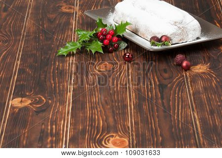 Stollen. Traditional Christmas Marzipan Pie. Decorations. Wooden