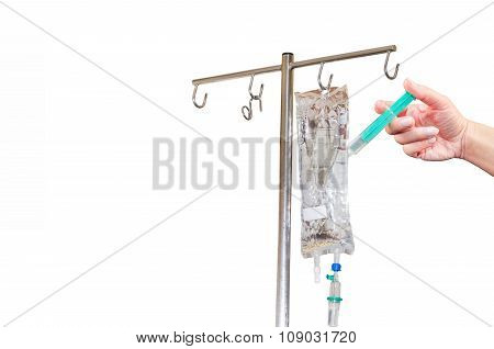 Hand With Syringe And Infusion Bags