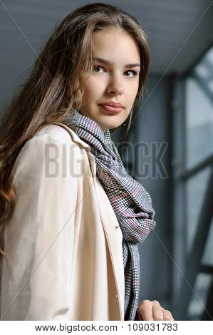 Portrait Of A Girl With A Scarf Around Her Neck