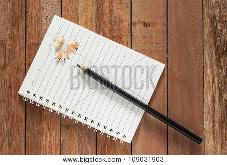 Paper Note With Pencil On Wooden