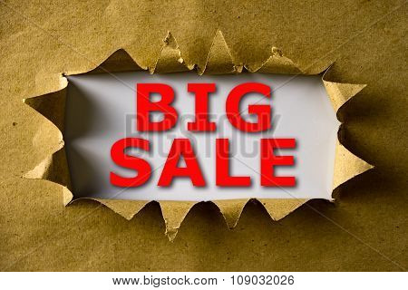 Torn Brown Paper With Big Sale Words