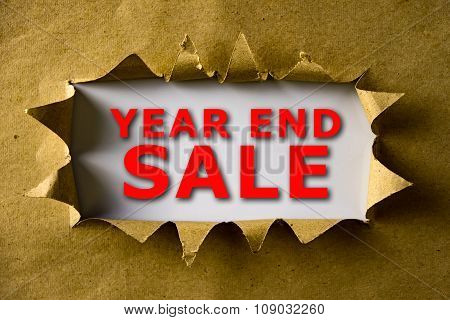 Torn Brown Paper With Year End Sale Words