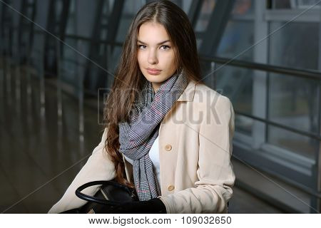 Girl With A Bag In Her Lap In Waiting For Departure