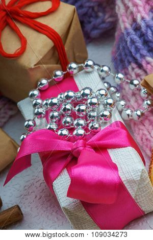 Christmas gift boxes, bijouterie and winter scarf