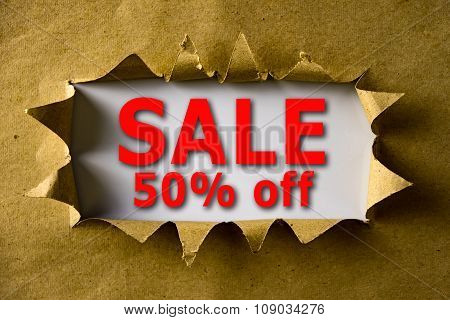 Torn Brown Paper With Sale 50% Off Words