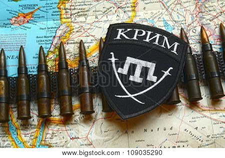 Kiev, Ukraine.NOV 13.Illustrative editorial. Chevron of Islamic extremist formation Crimea as part of Ukrainian Army.Background map  November 13, 2015 in Kiev, Ukraine