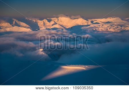 Morning Clouds In Winter Mountains