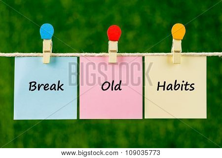 Words Of Break Old Habits On Sticky Color Papers Hanging By A Rope.