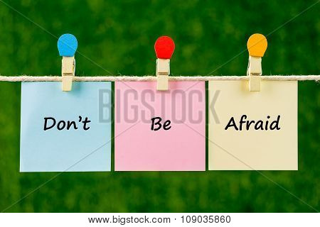Words Of Don't Be Afraid On Sticky Color Papers Hanging By A Rope.