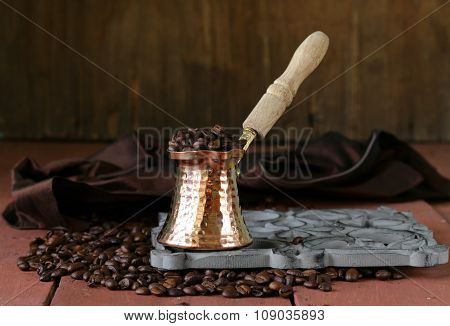 Still life coffee beans and coffee pot on a wooden table