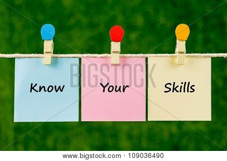 Words Of Know Your Skills On Sticky Color Papers Hanging By A Rope.
