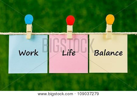 Words Of Work Life Balance On Sticky Color Papers Hanging By A Rope.