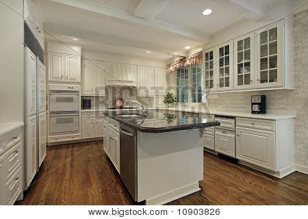 Kitchen With Cream Colored Cabinetry