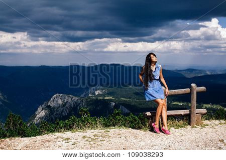 Woman Relax On Peak Of Mountain With Rainy Sky