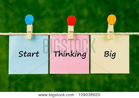Word Quotes Of Start Thinking Big On Sticky Color Papers Hanging On Rope.