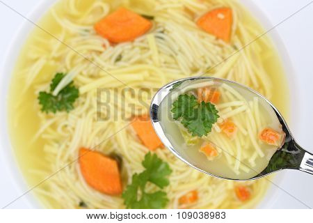 Eating Noodle Soup In Bowl With Noodles And Spoon