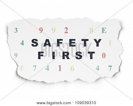 Protection concept: Safety First on Torn Paper background