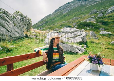 Country Style Long Hair Woman Relax In Mountain Cafe