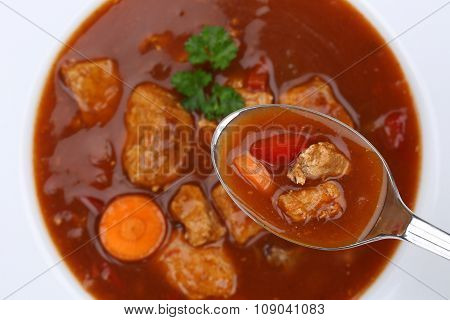 Eating Goulash Soup With Meat And Paprika On Spoon From Above