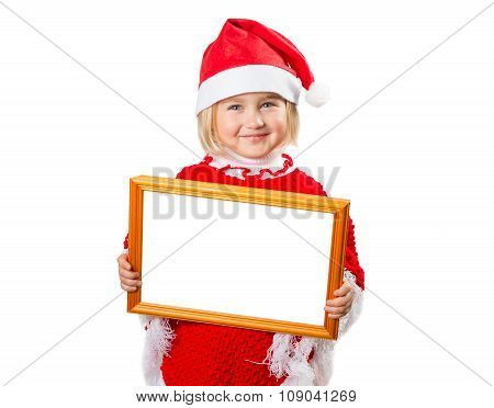 Little Girl In Hat Santa Claus Holding Frame With A White Background .