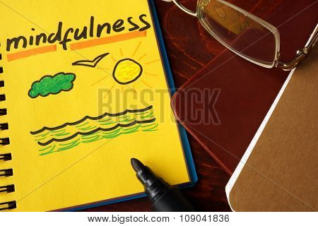 Notebook with mindfulness sign.
