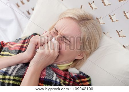 Sick young lady has caught a cold