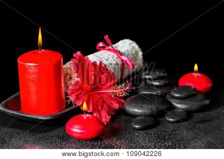 Beautiful Spa Composition  Of Hibiscus Flower With Dew, Red Candles And White Rolled Towel Tied With
