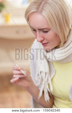 Pretty blond girl is suffering from flu