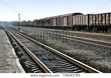 Many freight wagons and railway in perspective