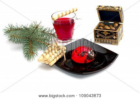 Plate With Red Cake, Tea, Nutlets And A Coniferous Branch